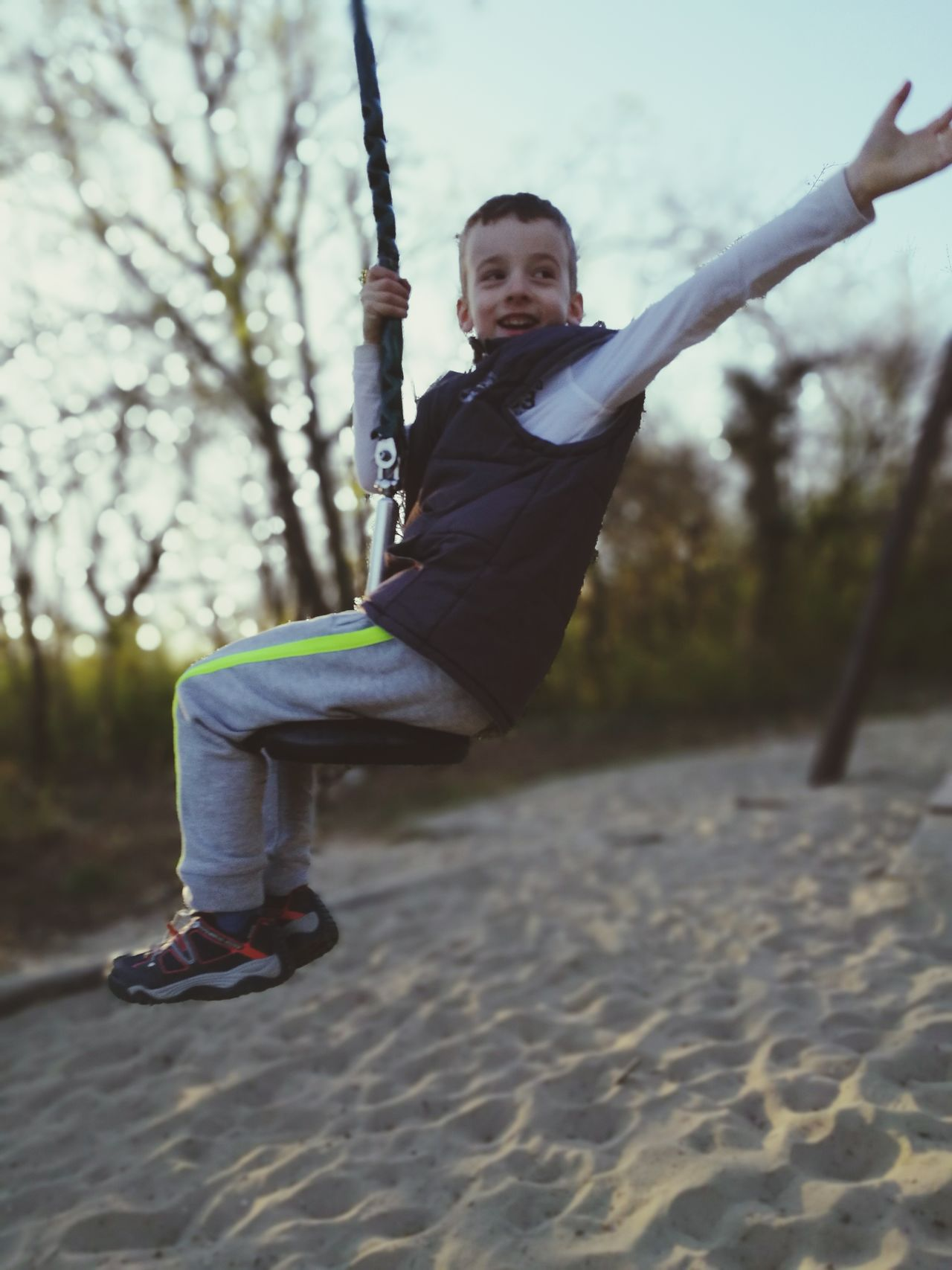 Full Length Childhood Children Only Child One Boy Only One Person Casual Clothing Males  Outdoors People Leisure Activity Gripping Swing Day Puddle Swing Set  EyeEmNewHere Adventure Park Slider Slide Happiness Happy Having Fun Long Goodbye The Great Outdoors - 2017 EyeEm Awards