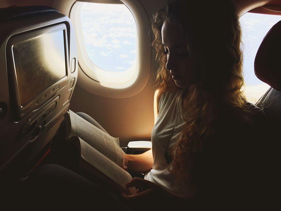 Beautiful stock photos of books, 20-24 Years, Air Vehicle, Airplane, Airplane Seat