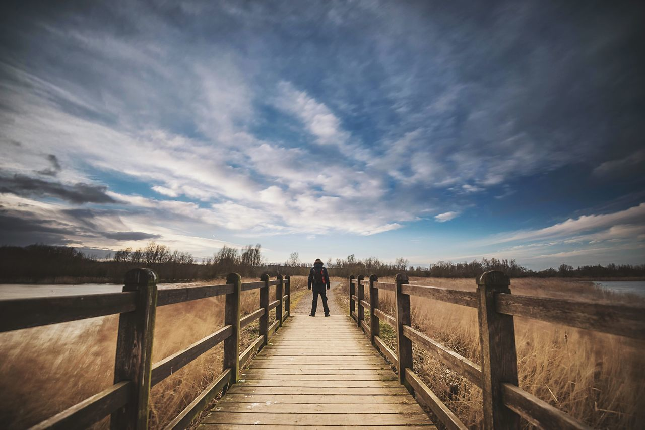 Great Wide Open Cloud - Sky Sky Railing Full Length Standing Pier One Person Real People Rear View Nature Walking Day Outdoors Beauty In Nature The Way Forward Scenics Wood Paneling Footbridge Landscape The Great Outdoors - 2017 EyeEm Awards One Man Only One Person Only Northamptonshire