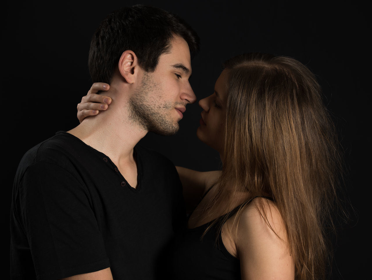 kissing couple Adult Adults Only Black Background Black Color Couple - Relationship Heterosexual Couple Kissimmee Kissing Love Men Night Passion People Romance Studio Shot Togetherness Touching Two People Young Adult Young Couple Young Men Young Women