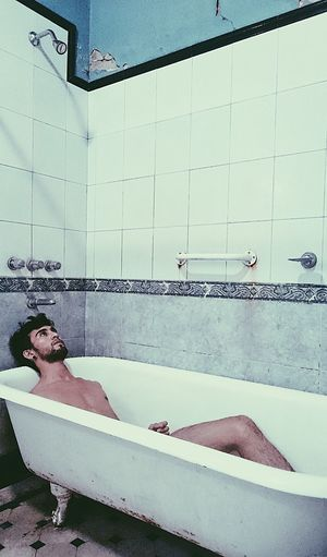 Alone.. Bodyart Bathtub Domestic Bathroom Bathroom Water One Person Full Length Real People Indoors  People Young Adult Adults Only Malemodel  Bodyshot Domestic Room Body Care Only Men Modelboy Shirtless One Man Only Men Shower Adults Only