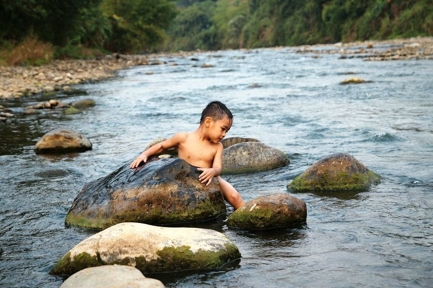 EyeEm Selects Shirtless Water Boys One Person One Boy Only Children Only Males  People Day Childhood Outdoors Fun Child Full Length Smiling Nature Tree Adult MySON♥ Love ♥ Ezzra Beauty In Nature Kali Klawing Jawa Tengah