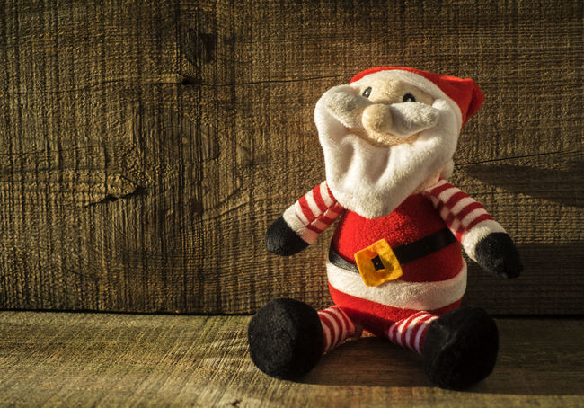 Santa Claus toy against wooden background Background Casual Clothing Childhood Claus Humor Imagination Man Made Object Mask - Disguise Red Santa Toy Wooden
