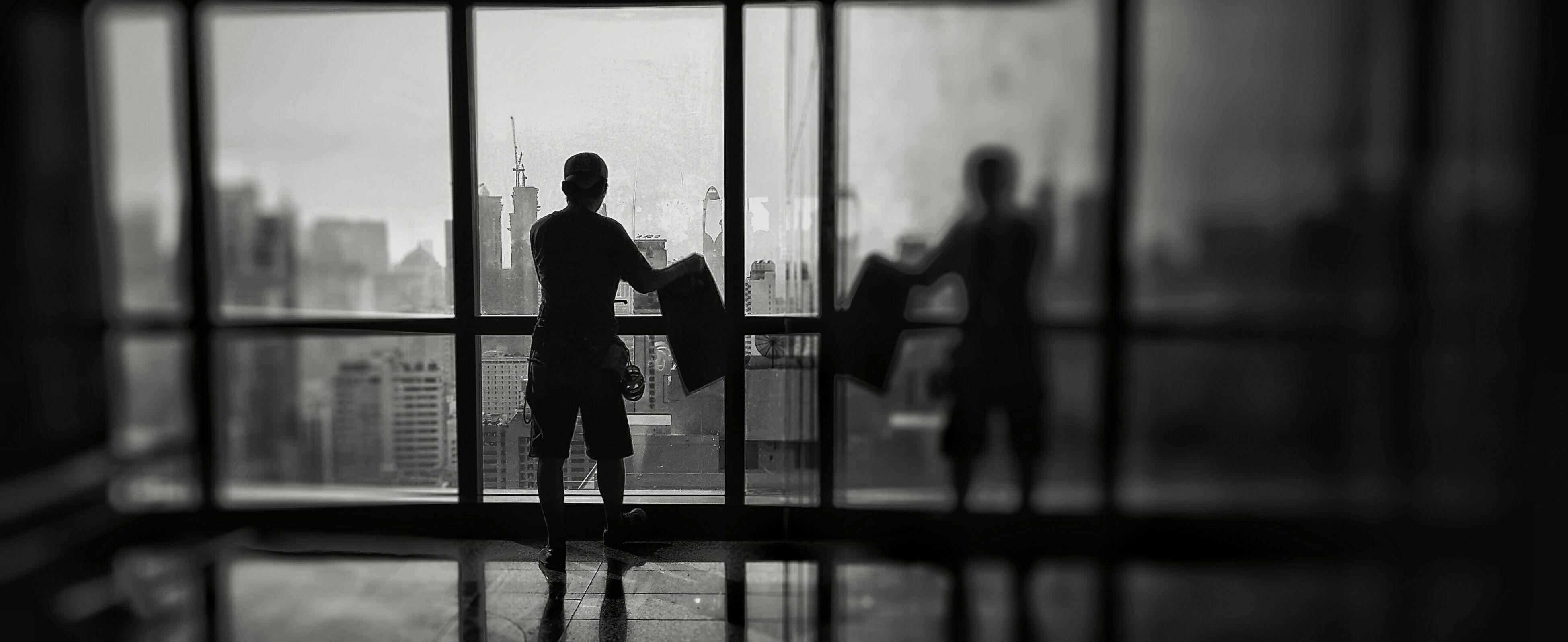 indoors, silhouette, men, lifestyles, window, glass - material, full length, walking, leisure activity, person, standing, rear view, transparent, selective focus, reflection, shadow, railing