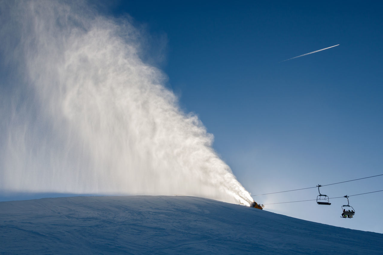Landscape of snow cannons working at the ski slope on a sunny day Airplane Cold Lift Mountain Nature No People Outdoors Panorama Resort Sky Slope Snow Snow Cannon Snow Gun Snowgun Sport Sunset Winter