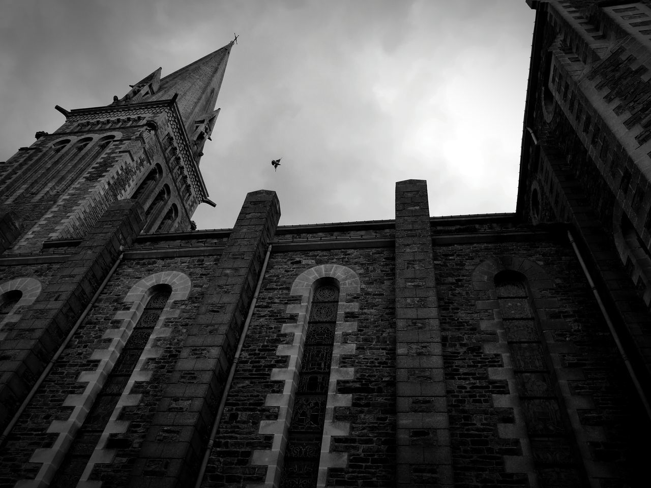 low angle view, building exterior, architecture, built structure, sky, day, outdoors, cloud - sky, history, religion, spirituality, travel destinations, no people, place of worship, city