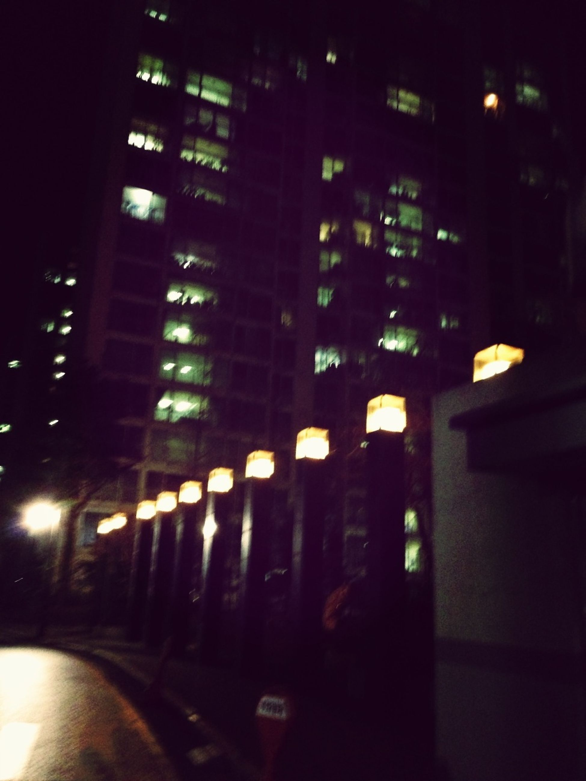 illuminated, building exterior, architecture, night, built structure, city, street, building, transportation, office building, city life, modern, city street, road, car, skyscraper, window, street light, light - natural phenomenon, outdoors