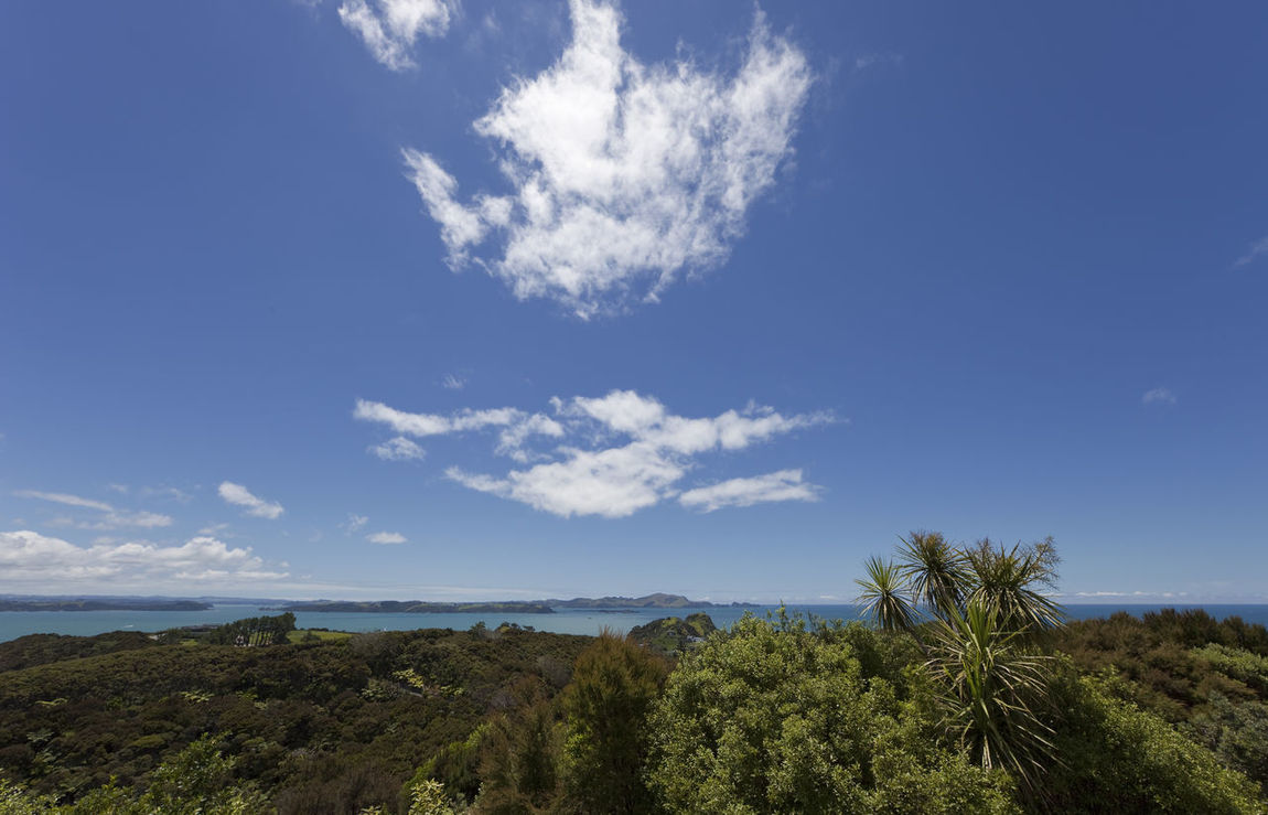 Bay of Islands with blue Sky and white Clouds - View from Flagstiff Hill in Russell, Northland, North Island, New Zealand Bay Of Islands Beauty In Nature Blue Sky White Clouds Coastline High Angle View Landscape Landscape_Collection Landscape_photography Lush Foliage Mountain Nature New Zealand New Zealand Scenery No People North Island Northland Panorama Russell Scenery Scenics Sea Seascape Tranquility Travel Destinations Wide Angle