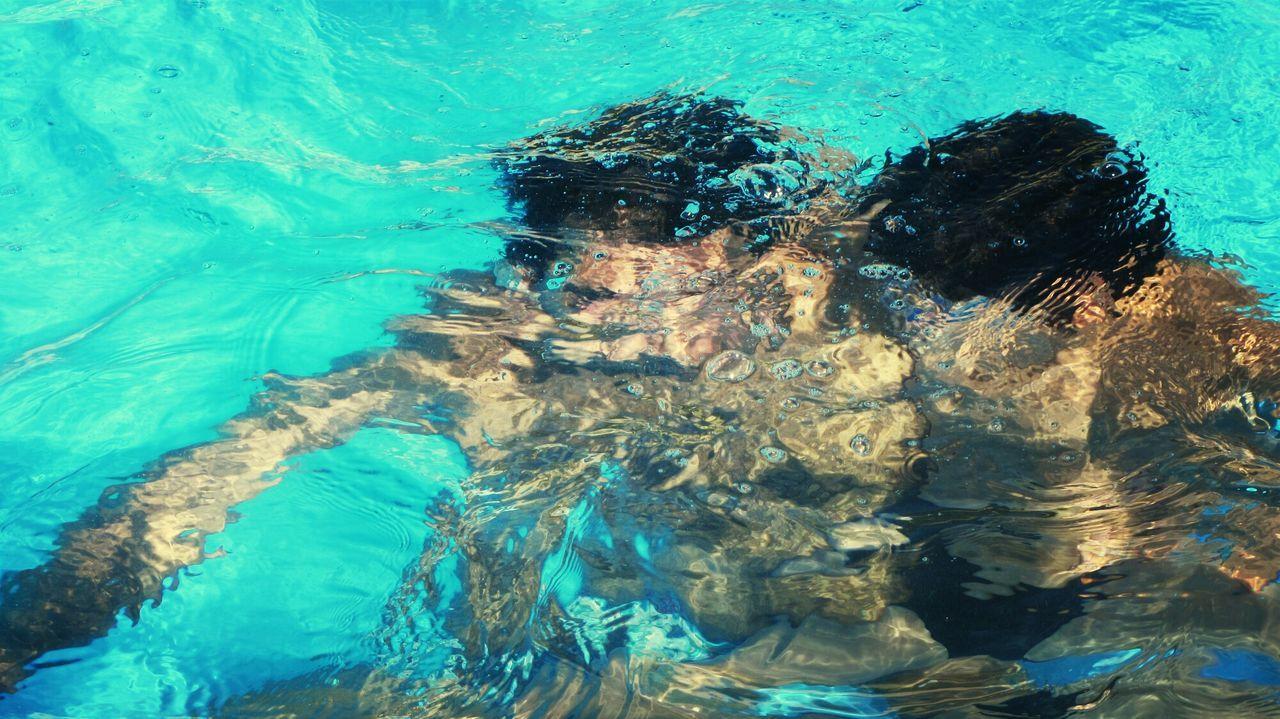 Men in swimming pool