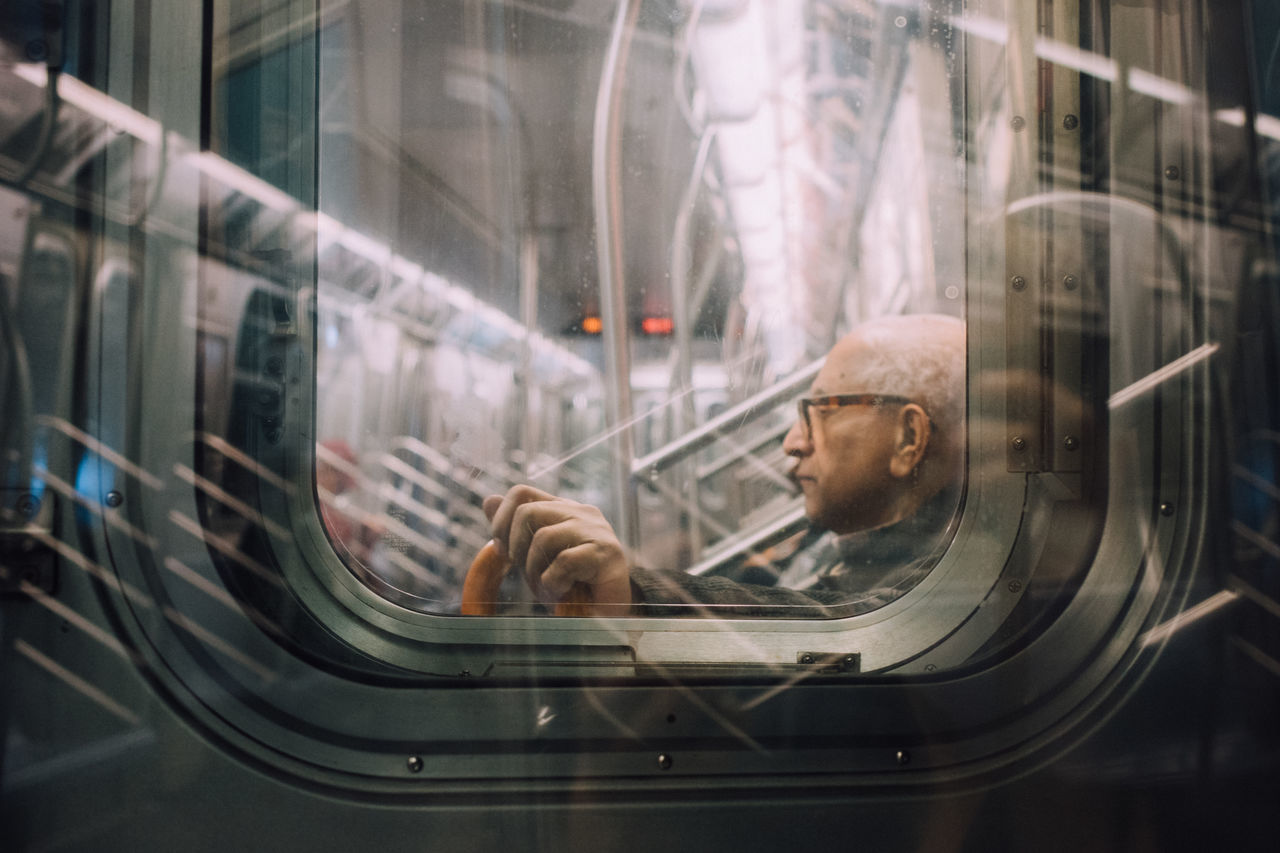 At a glance through. Close-up Daily Commute Illuminated Mode Of Transport Mood Captures Reflections Selective Focus Street Photography Subway Portraits Through The Window Transitional Moments Transportation Up Close Street Photography The Street Photographer - 2016 EyeEm Awards My Daily Commute