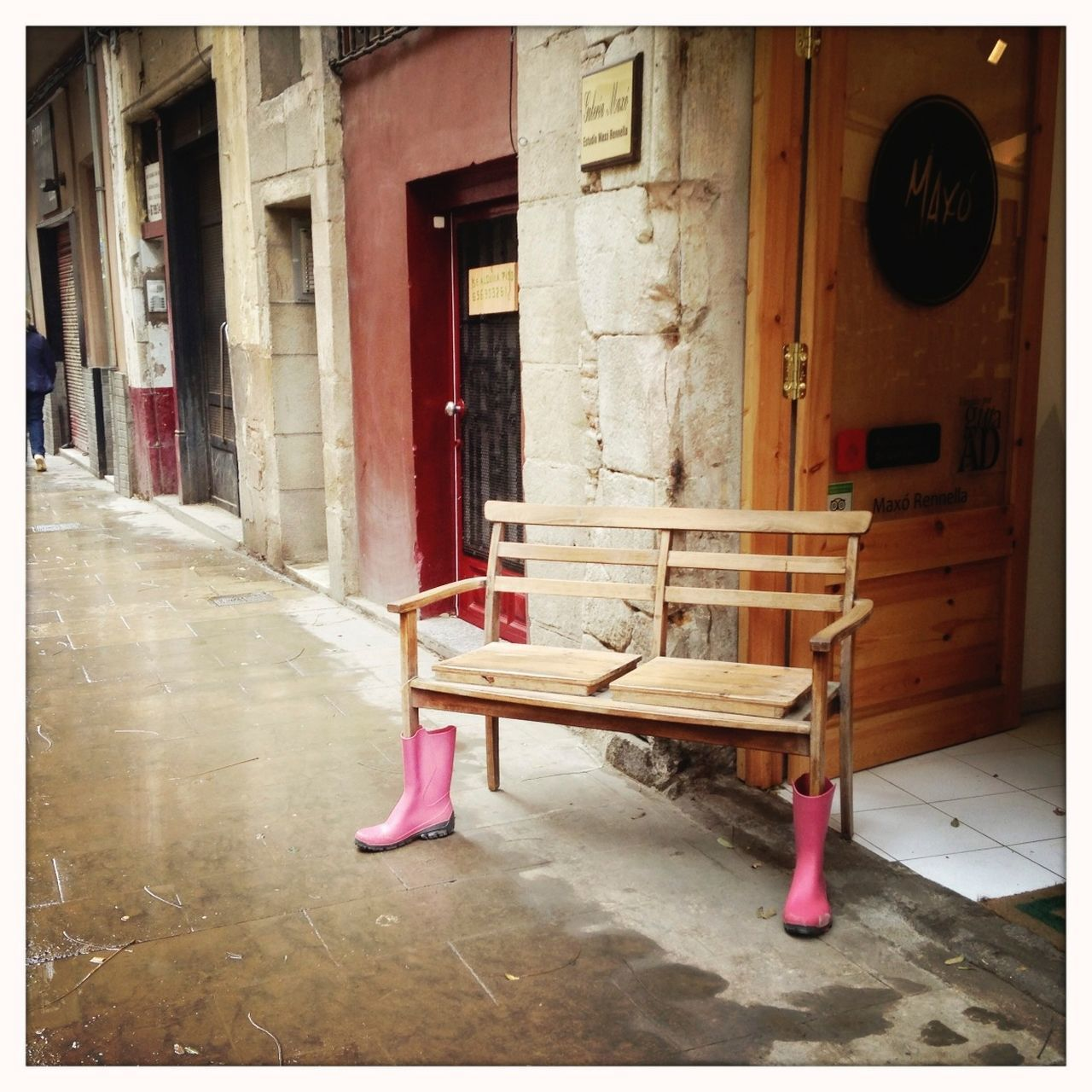 When it gets wet in Barcelona... Street Life Rainy Days Streetphotography Fun Bench Rubber Boots Boots When It's Raining Deceptively Simple