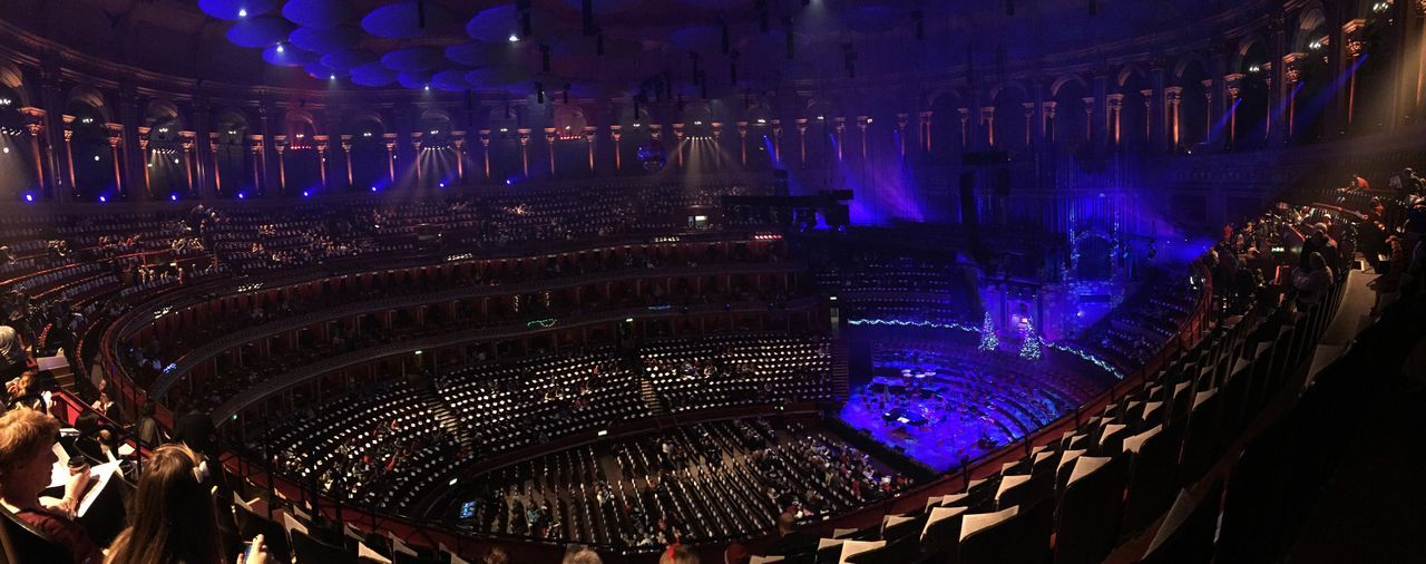 illuminated, architecture, night, indoors, built structure, travel destinations, panoramic, large group of people, people