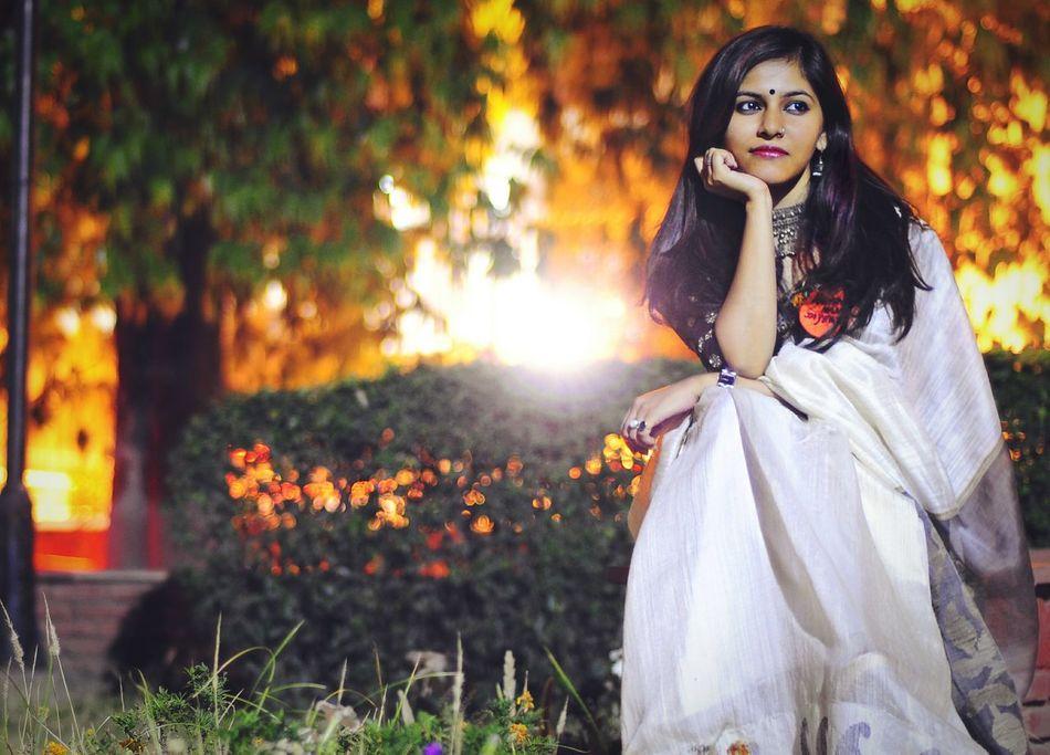 Indian BeautyBeauty Women Dress Indian Culture  Saree EyeEmNewHere Bindi Night Bokeh Glamour Fashion Beautiful People Outdoors Indian Culture  Long Exposure Women Around The World