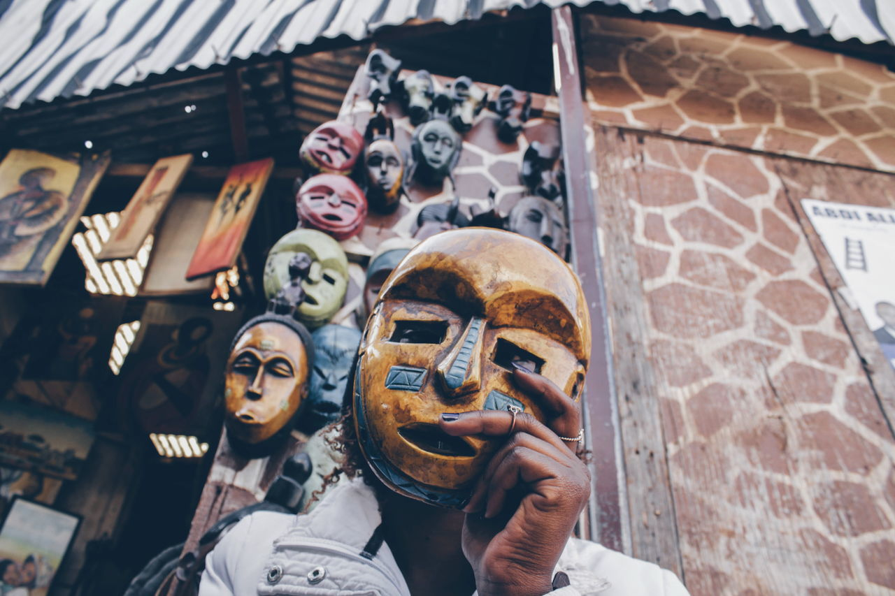 Mask - Disguise Outdoors Arts Culture And Entertainment Spooky Day Lifestyles Africa Teenagers  Canon Camera Detail EyeEm Gallery Leisure Activity Streetphotography One Woman Only EyeEmNewHere Portrait Close-up Low Section City