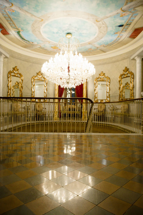 The interior of the Chateau des Fountaines in Canet d'Aude. Ces't magnifique! Baroque Style Chandelier Chateau Des Fountaines Château Decoration Kitsch Lights Maginificent Work Uday Hussein