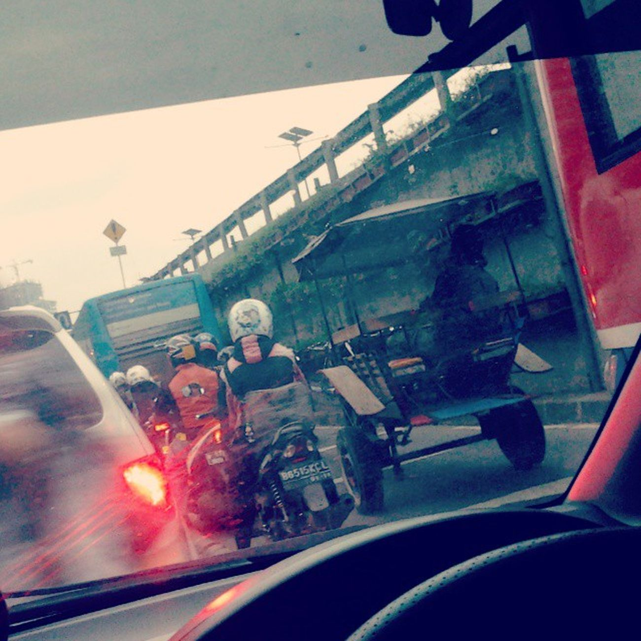 Rare moment, when The two-wheeled carriage by horse (also called : andong, sado or delman) trapped on the traffic jam being with common vehicles. Andong Delman Sado Traditional Vehicle public Transportation Trapped traffic dki jkt jakarta indonesia thursday afternoon november 2014 Ancient unique Vintage Road
