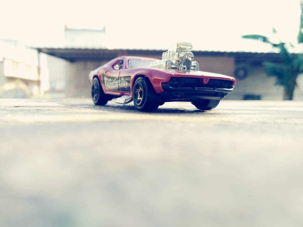 toy, childhood, selective focus, toy car, no people, outdoors, close-up, day, sky
