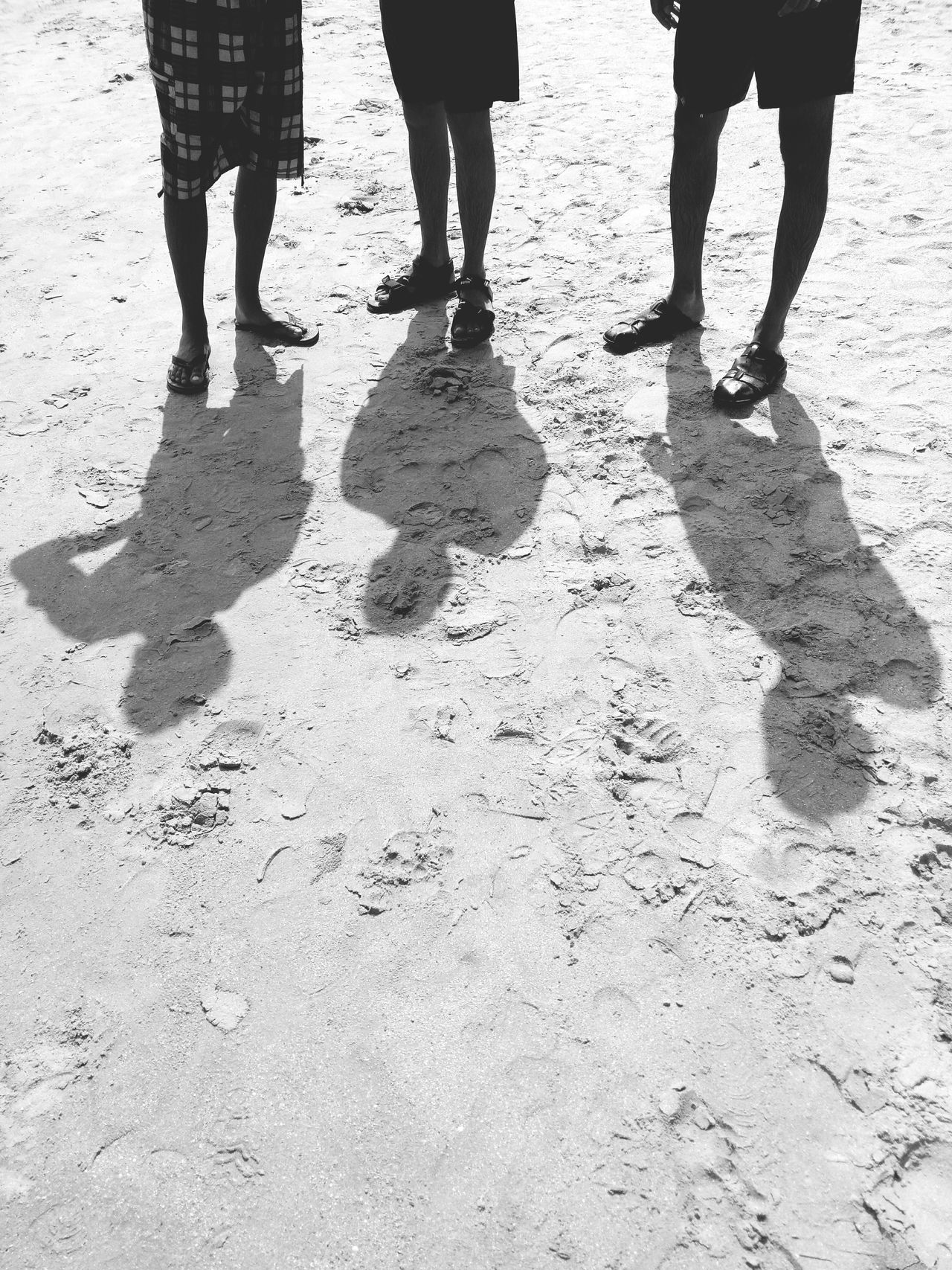 Low Section Human Leg Shadow Togetherness Sunlight Day Human Body Part Two People Men Outdoors Bonding Sand Beach Adult Standing Lifestyles Real People Adults Only People Only Men Travel Destinations Standing Vacations Beachtime Travelling Photography