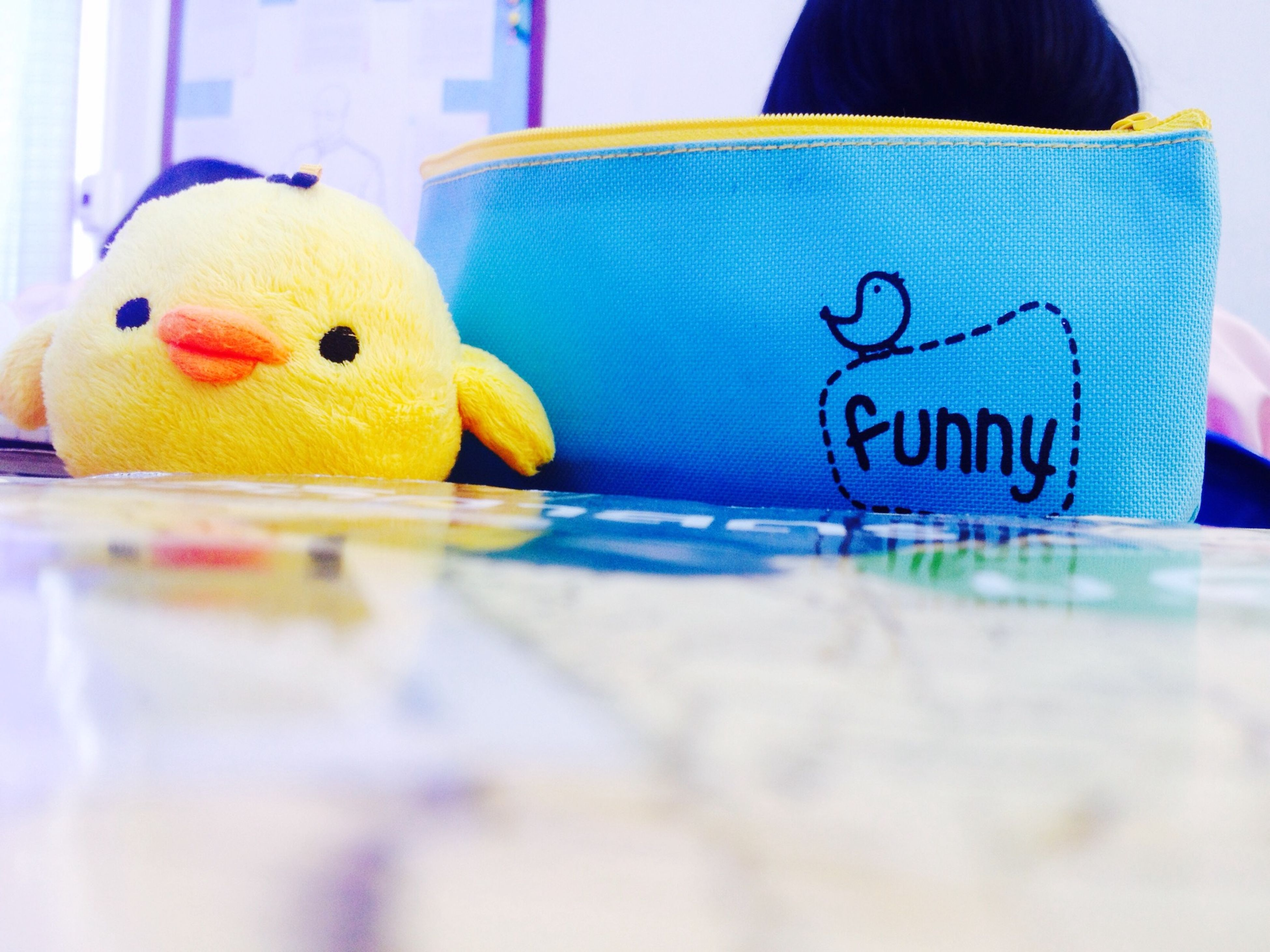 indoors, toy, multi colored, childhood, close-up, blue, animal representation, focus on foreground, selective focus, yellow, colorful, creativity, art, variation, western script, text, art and craft, stuffed toy, no people, still life