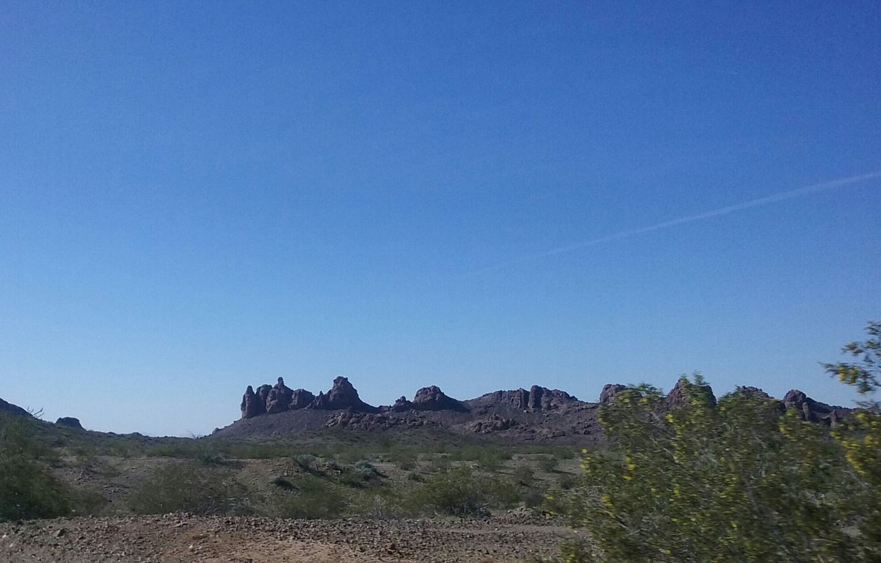 rock - object, blue, rock formation, nature, clear sky, no people, day, mountain, landscape, tranquil scene, arid climate, tranquility, outdoors, beauty in nature, scenics, desert, physical geography, sky