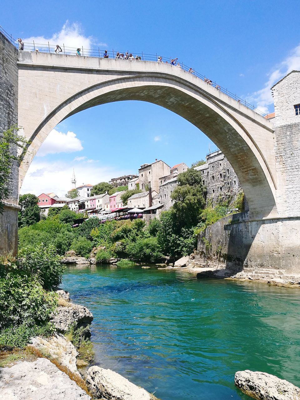 architecture, arch, bridge - man made structure, built structure, river, connection, water, sky, bridge, day, outdoors, no people, tree, nature