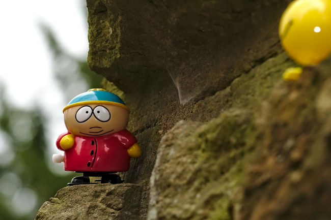 mind the gap Adventurous Best Friends Cartman Close-up Figurines  Focus On Foreground Low Angle View Nikon No People Outdoor Photography Plastic Red Lips Scary Places Selected Focus Smily Southpark Still Life Stone Wall Today's Hot Look Toy Adventures Yellow