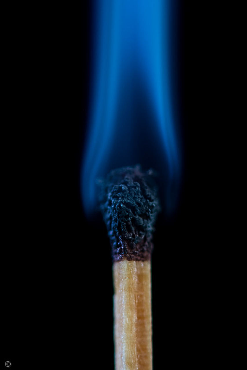 studio shot, black background, matchstick, close-up, burning, no people