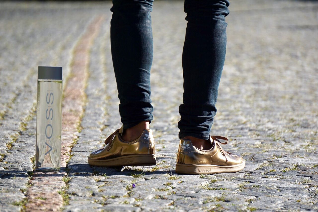 low section, standing, shoe, one person, day, human leg, outdoors, real people, men, close-up, adult, adults only, people