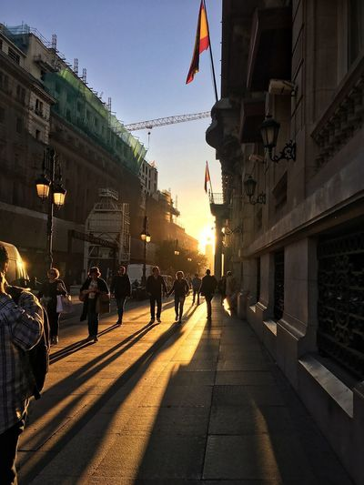 Building Exterior Flag Built Structure Architecture Sunlight Patriotism Large Group Of People Walking Outdoors Men Day Women Real People Sky Shadow Statue City Nature Adult People Madrid Madrid Spain Construction Area