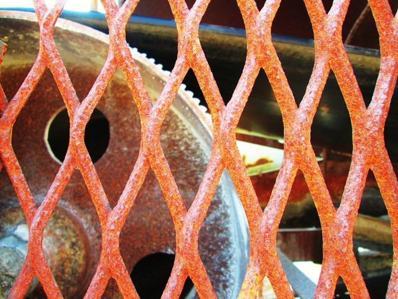 Machine for a macadam factory. Vividly and lubberly. Machine Factory Colors Vivid Lubberly Gear Iron Fence