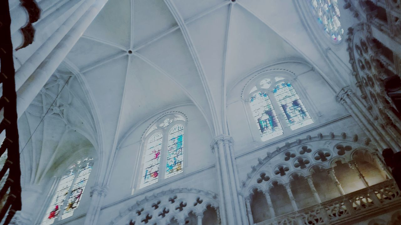 religion, indoors, place of worship, architecture, low angle view, spirituality, ceiling, no people, built structure, day