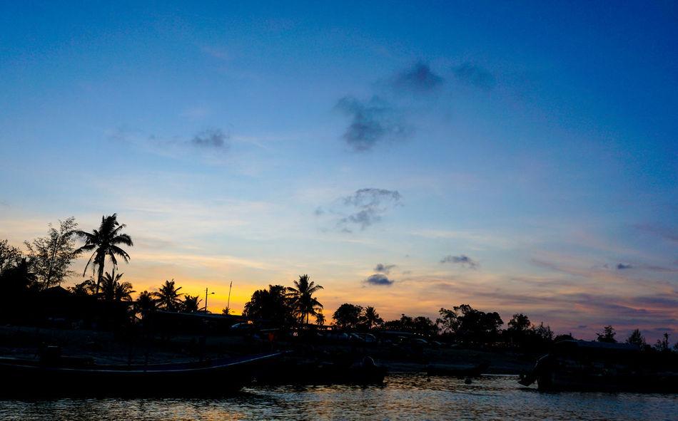 Beautiful fisherman village silhouette during sunset