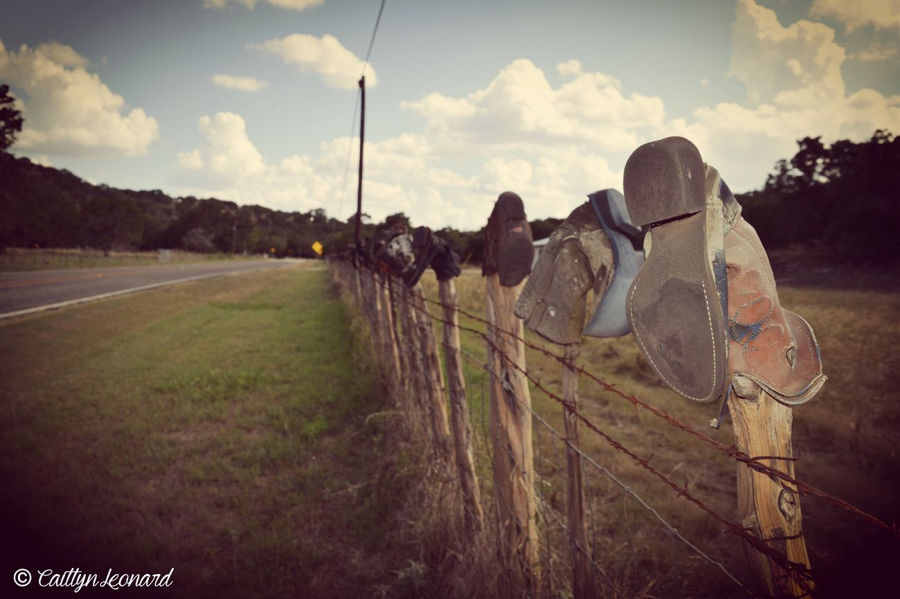 Fence Line Of Boots Leave Your Boots Here Mark Your Territory West TX Different Fun Things In Texas Hill Country