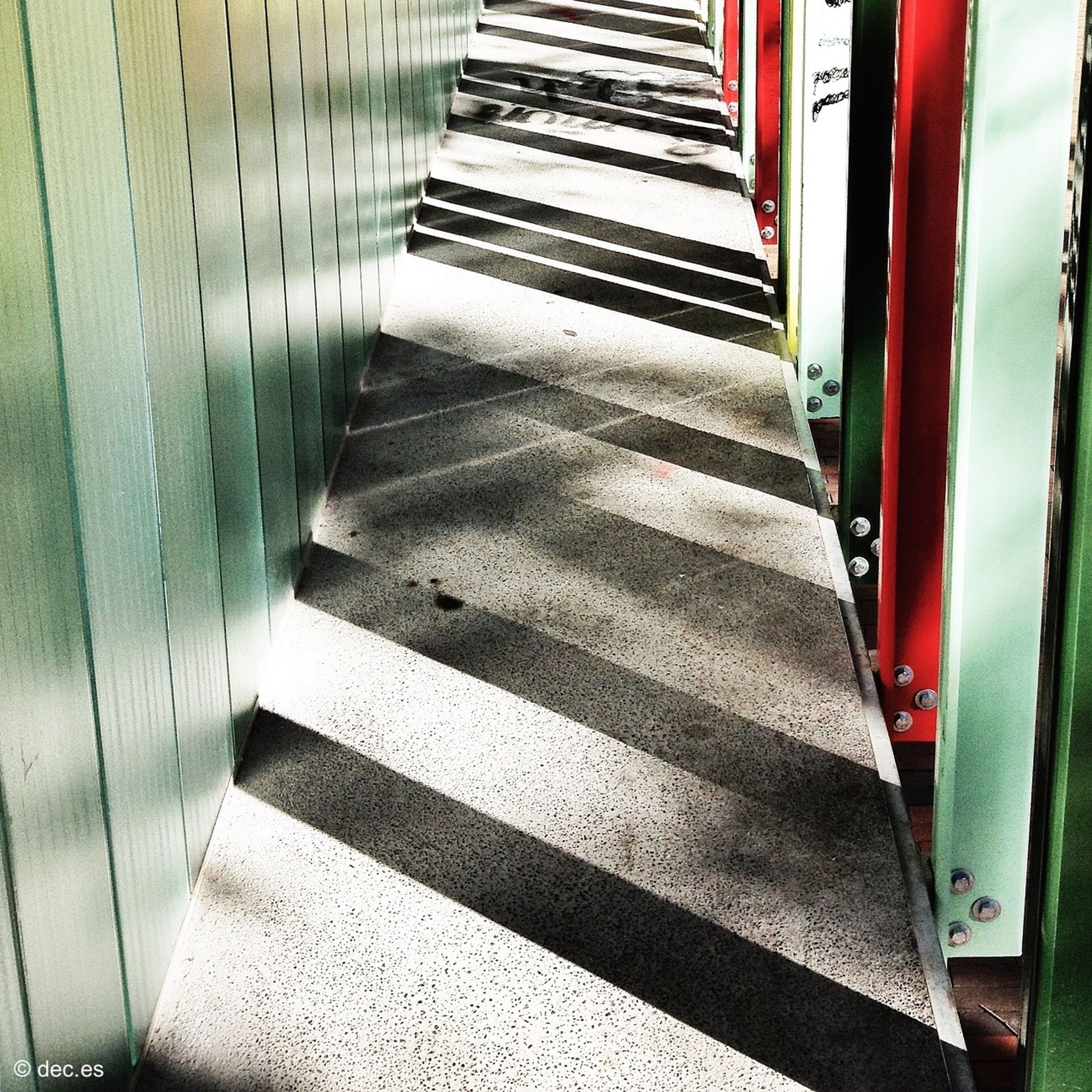 steps, high angle view, transportation, the way forward, staircase, steps and staircases, railing, indoors, empty, sunlight, in a row, no people, shadow, day, road marking, absence, part of, road, red, striped