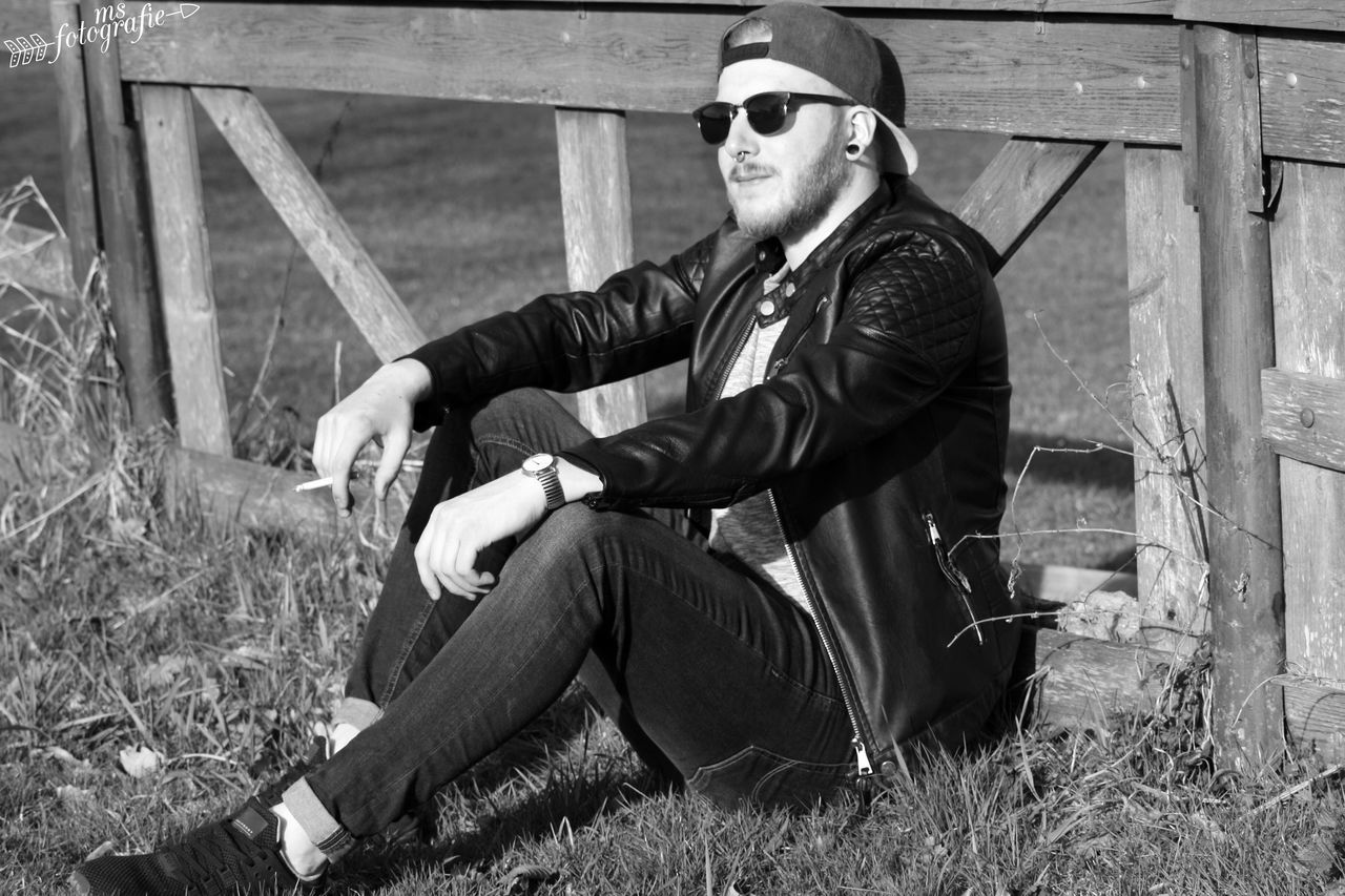 Resist Sunglasses One Man Only Sitting Young Adult One Person Young Men Outdoors Handsome Portrait People Grass Sunny Day Cigarette  First Eyeem Photo