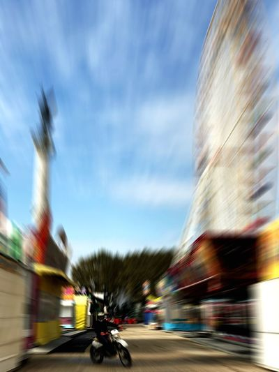 Pure fair speed Blurred Motion Speed Motion Transportation Building Exterior Long Exposure Outdoors Road Architecture Urgency Defocused Traffic Built Structure Multi Colored Sky Day No People Horizontal Finish Line  Motorcycle EyeEm Best Shots Eye4photography  Photooftheday Speed Limit