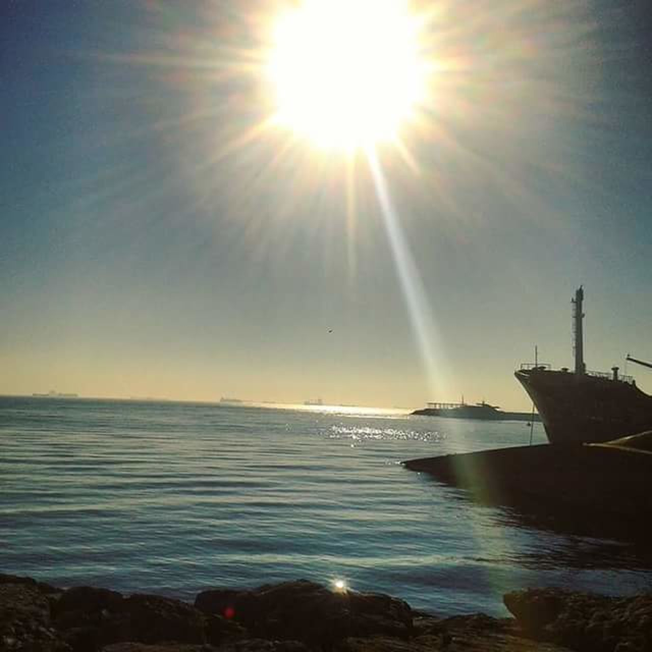water, sun, sunbeam, sea, lens flare, sunlight, beauty in nature, nature, sky, bright, horizon over water, scenics, no people, outdoors, nautical vessel, beach, day, wave