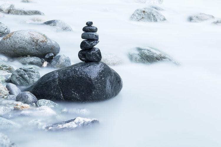 Pile of black stones in a river Nature Sauna Black Stones Pile River Stones Tranquil Scene Zen