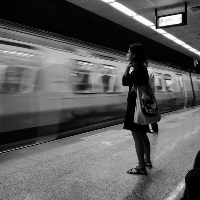 One Person Passenger On The Move Transportation Anticipation Full Length Train - Vehicle Travel Only Women People Waiting Blurred Motion Adults Only Railroad Station Standing Subway Train One Woman Only Public Transportation Real People Motion