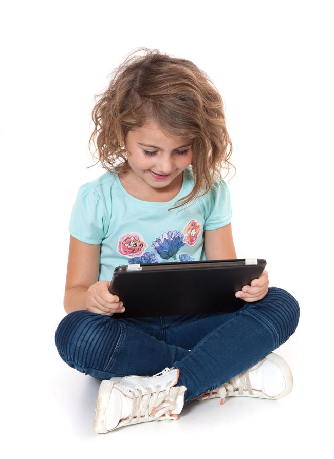 Young girl using tablet device. All on white background. Child Childhood Curly Hair Full Length Girl Girlhood Isolated On White Isolated White Background Kid One Person Sitting Studio Shot Tablet Computer Tablet Device Tablet Pc White Background Young Girl