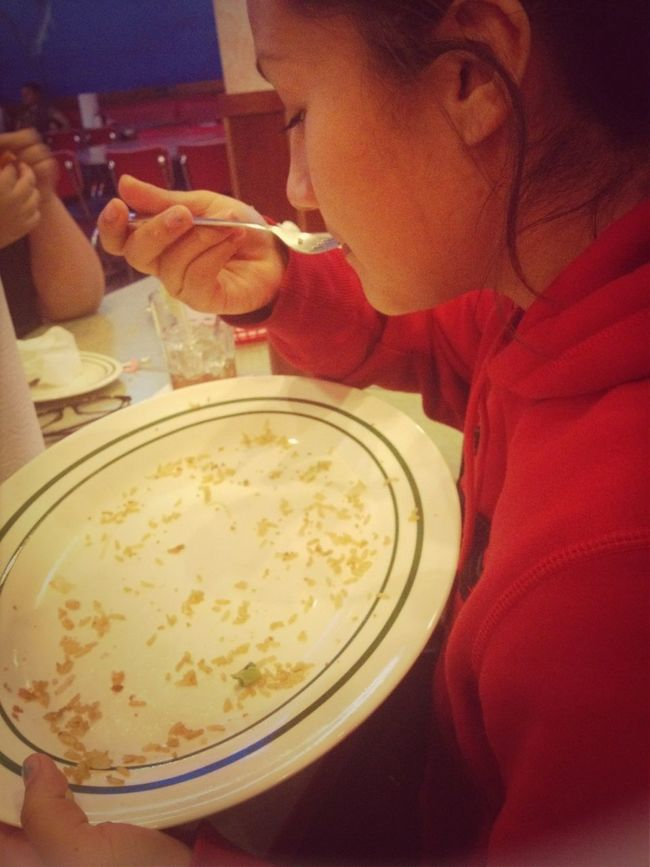 This girl ate the whole large shrimp fried rice, Her favorite!