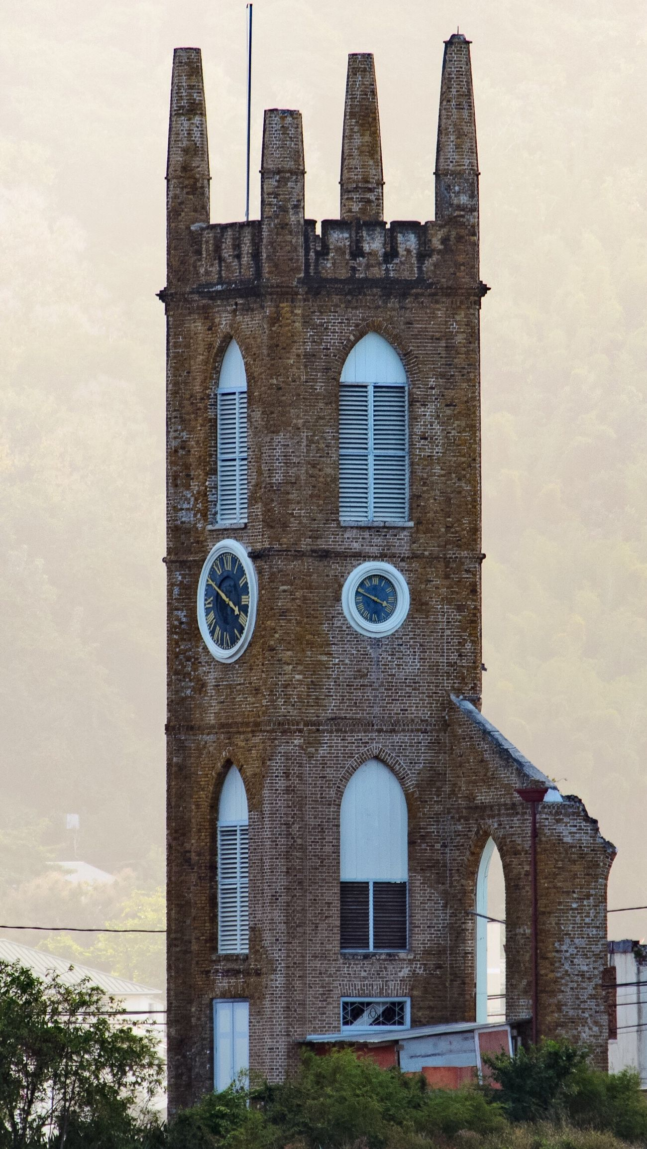 Grenada. Tower Clock Tower Mist Misty Morning Haze Brick Building Sunshine Culture Eye4photography  EyeEm Best Edits EyeEm Best Shots EyeEm Gallery EyeEm Masterclass EyeEmBestPics Outdoors No People Nikon EyeEm Taking Photos Travel Traveling Building Built Structure Urban Urban Landscape