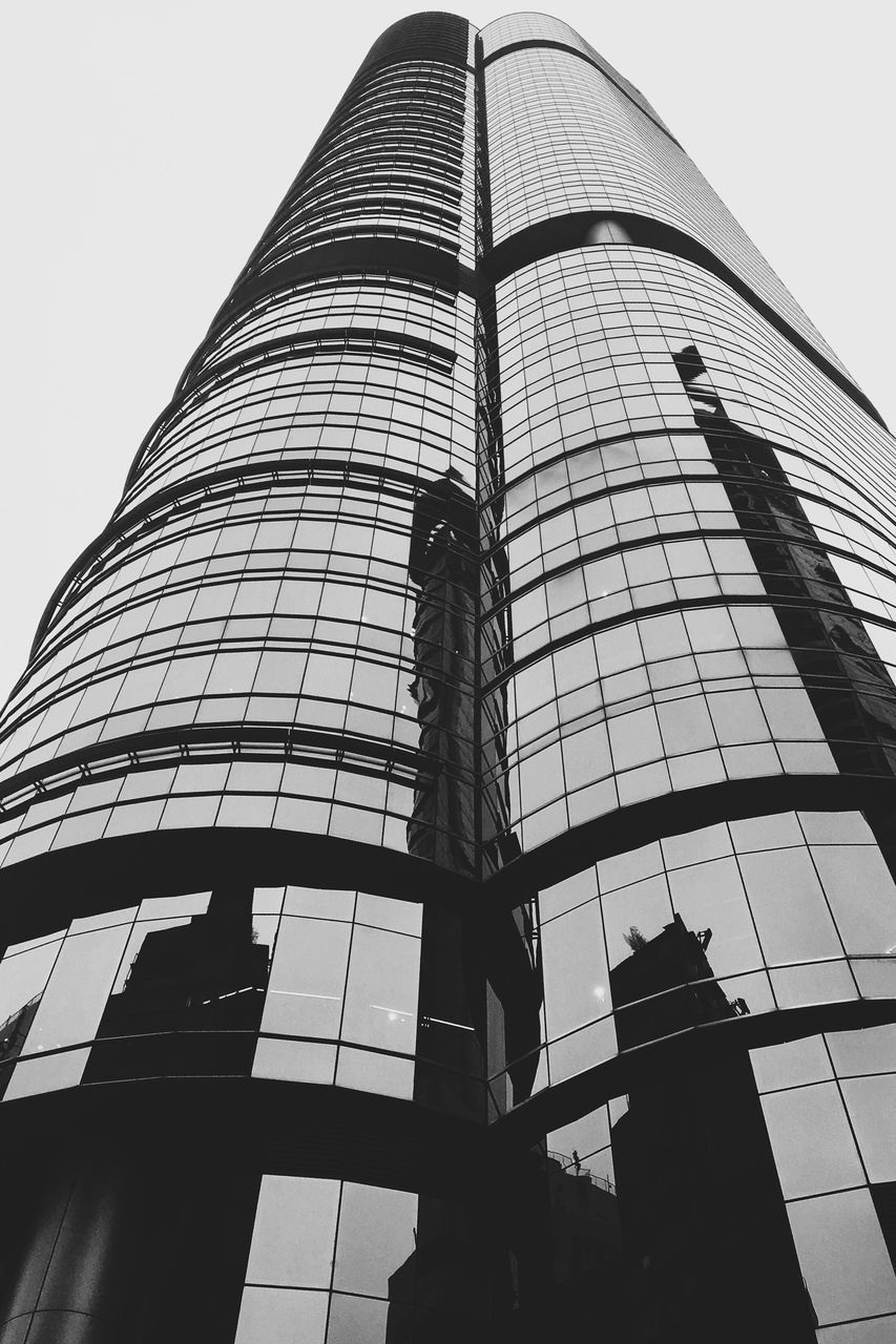 architecture, low angle view, built structure, building exterior, modern, tall - high, tower, skyscraper, tall, day, outdoors, city, no people, sky, corporate business, clear sky, window washer