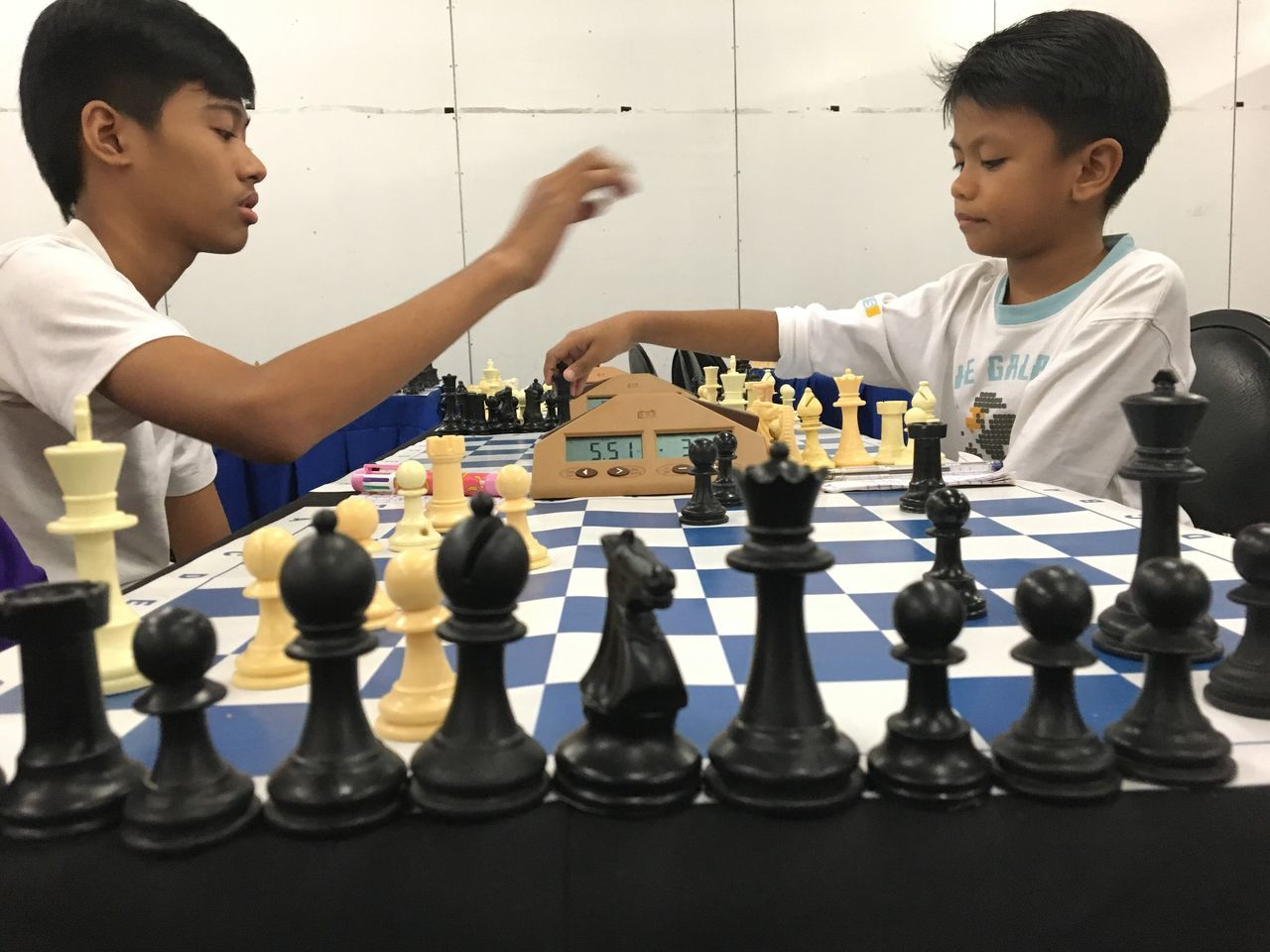 chess, chess piece, boys, strategy, playing, leisure games, chess board, childhood, competition, learning, concentration, education, leisure activity, indoors, real people, elementary age, challenge, knight - chess piece, pawn - chess piece, school uniform, game, day, intelligence, queen - chess piece