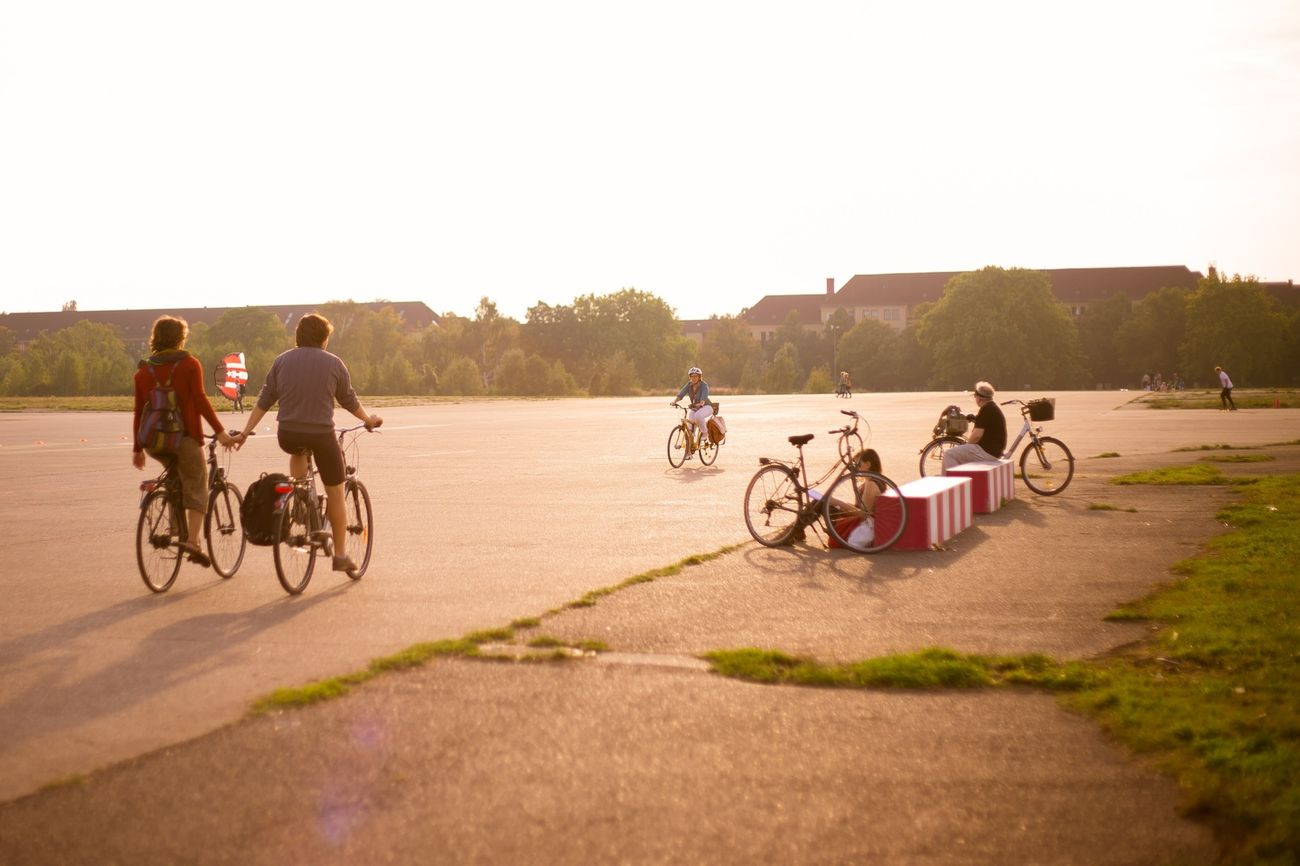 Cycling off into the sunset at Tempelhofer Park, Berlin. Bicycle Berlin Tempelhofer Feld Sunset