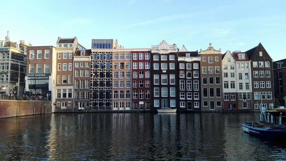 Amsterdam Architecture Built Structure Channels City Cityscape No People Outdoors Row House Sky Travel Destinations Water