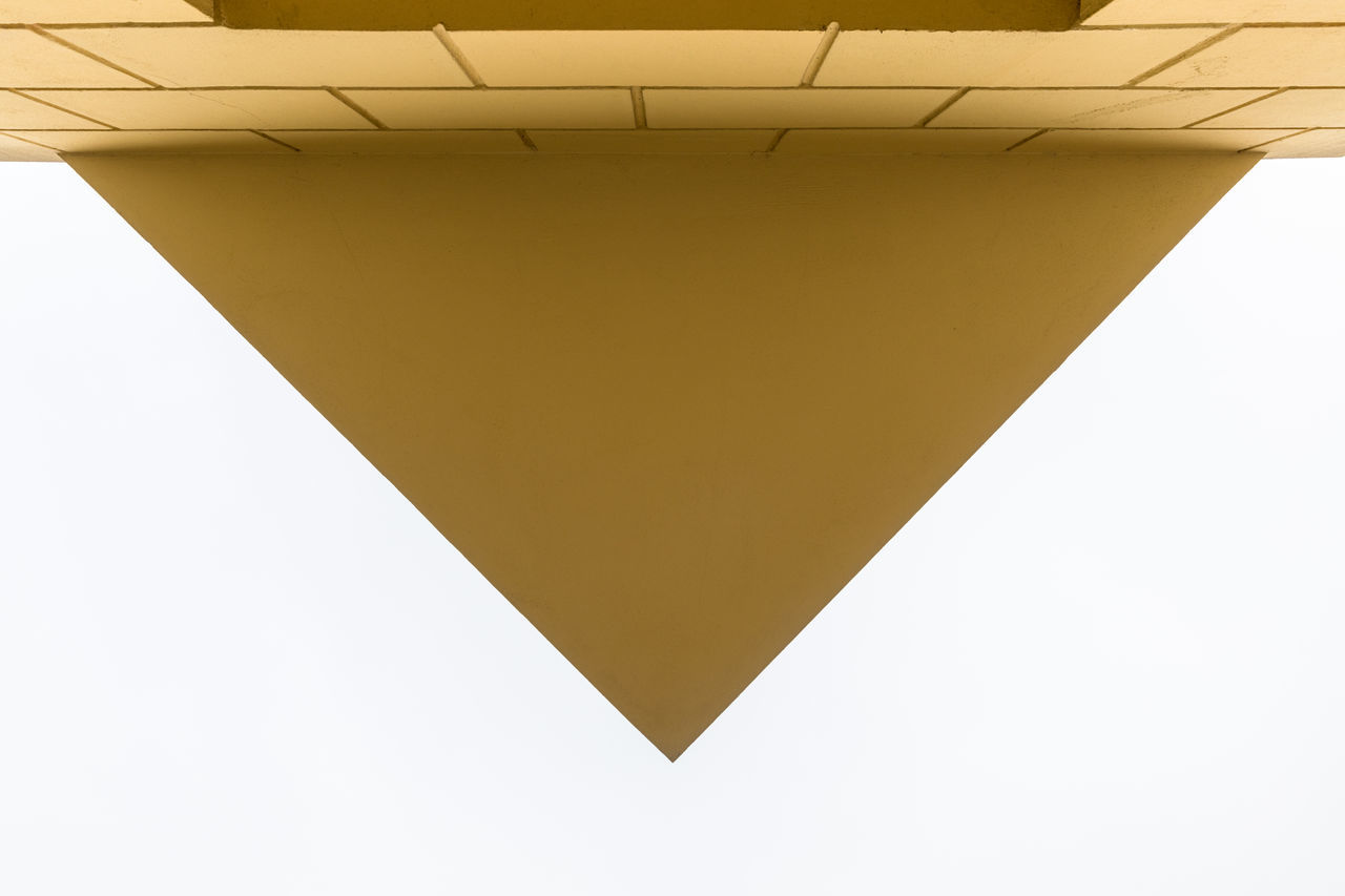Building corner in triangle shape Abstract Angle Architecture Brick Wall Building Exterior Building Feature Built Structure City Close-up Concrete Copy Space Corner Day Directly Below Geometric Shape Low Angle View Outdoors Overcast Paint Sky Triangle Building Triangle Shape Wall - Building Feature White Color Yellow