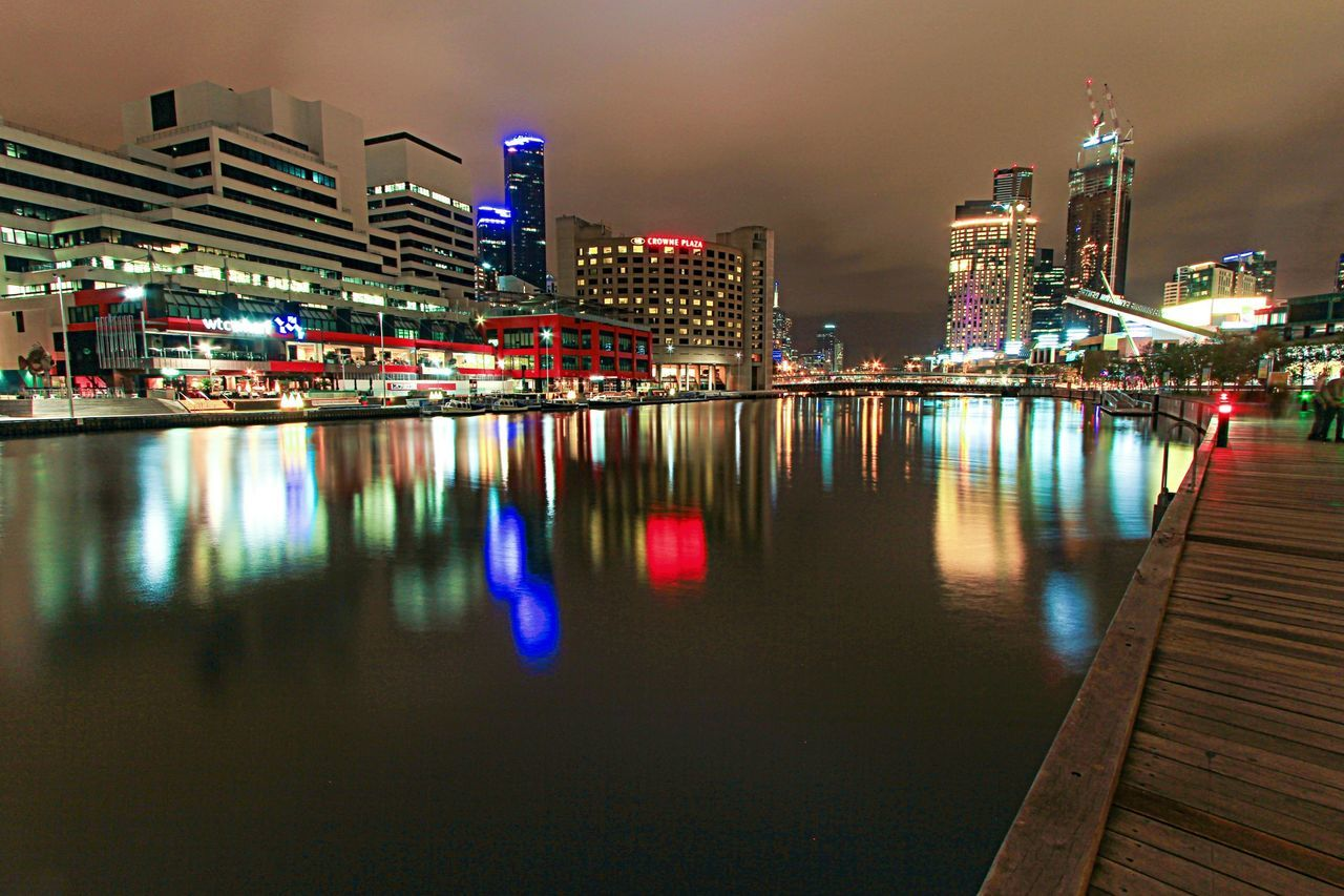 architecture, illuminated, building exterior, night, built structure, skyscraper, city, reflection, travel destinations, modern, outdoors, waterfront, water, no people, sky, cityscape, urban skyline