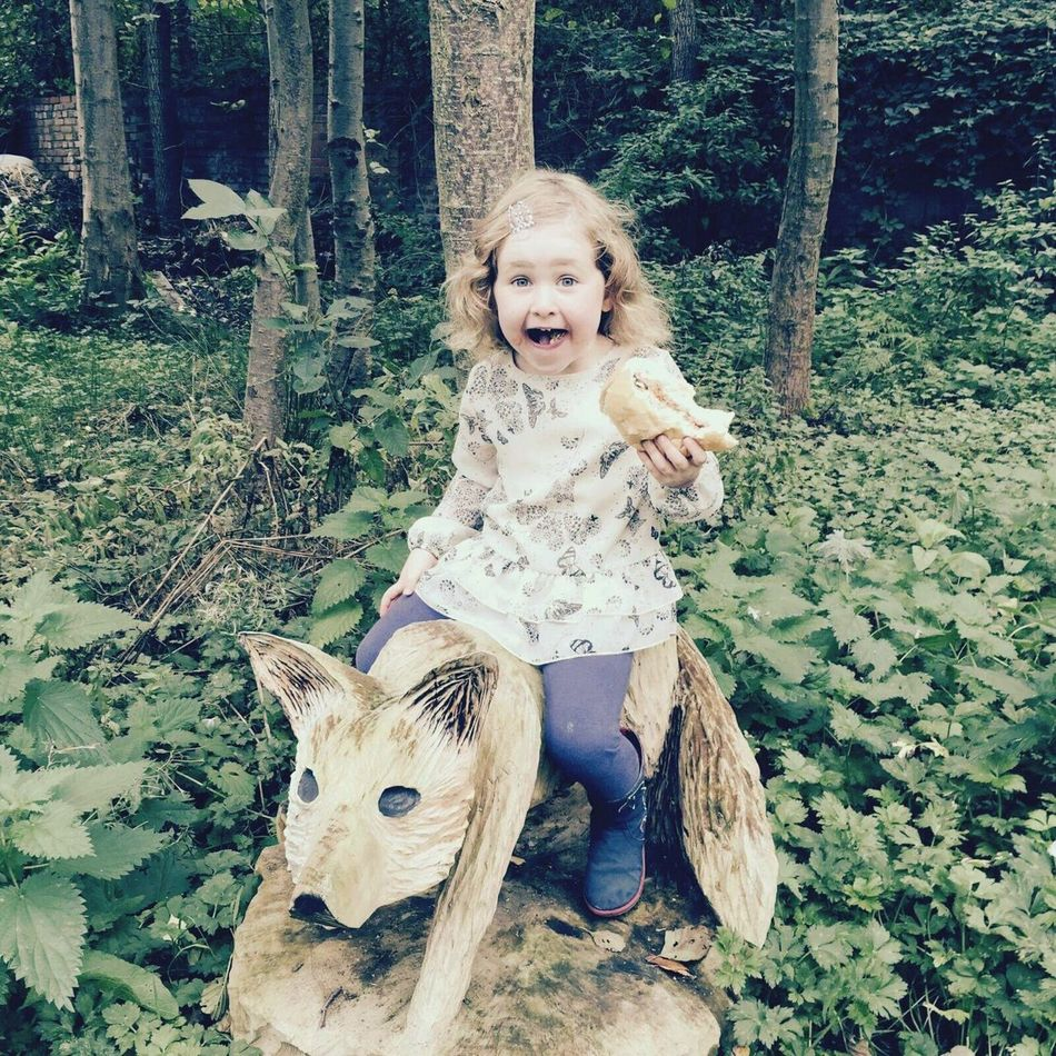 Childhood Looking At Camera One Person Portrait Tree Blond Hair Real People Outdoors Lifestyles Day Animal Themes Nature People Lovely Day Beautiful Nature Neice Carved Wood Carving Carved In Wood Carved Animal Carved Fox Child