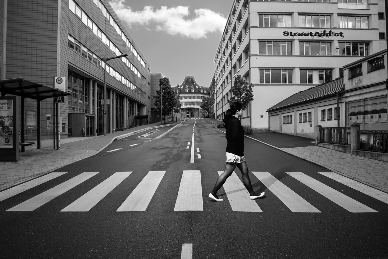 Architecture Building Exterior Built Structure BYOPaper! City Cloud - Sky Day Full Length One Person Outdoors People Real People Road Sky Street Transportation Walking Zebra Crossing